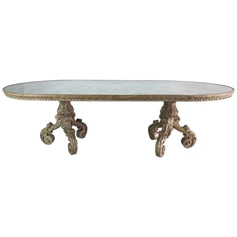 italian silvered wood dining table with mirrored top at