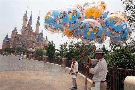 theme park liverpool disney opens theme park in shanghai china liverpool echo