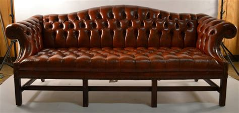 camel back leather sofa 301 moved permanently