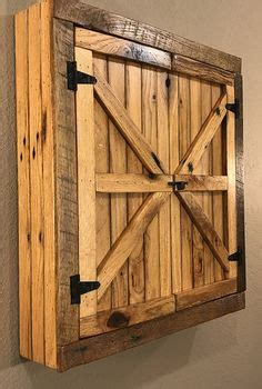 reclaimed wood dartboard cabinet gun cabinet made from pallets could use chicken wire on