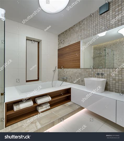 bathroom on the right song bathroom in a modern style with light tiles on the left wall and floor on the left