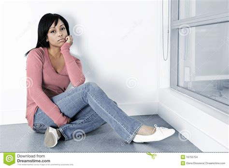 depressed sitting on the floor stock photo image