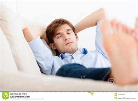 lay down on the couch man lying down on sofa stock photo image 29893930