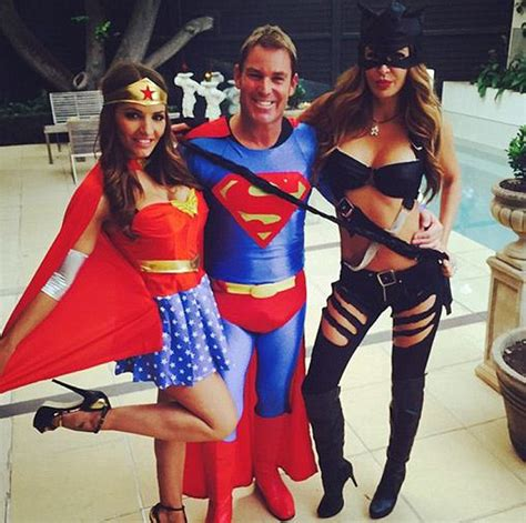 Kaos Going Merry shane warne dresses as superman and is joined by models