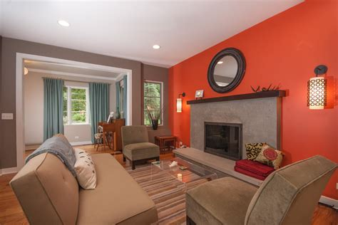 burnt orange wall paint Living Room Contemporary with accent wall antlers armless