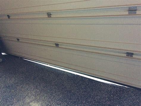 uneven garage floor door seal garage door uneven floor seal floor matttroy