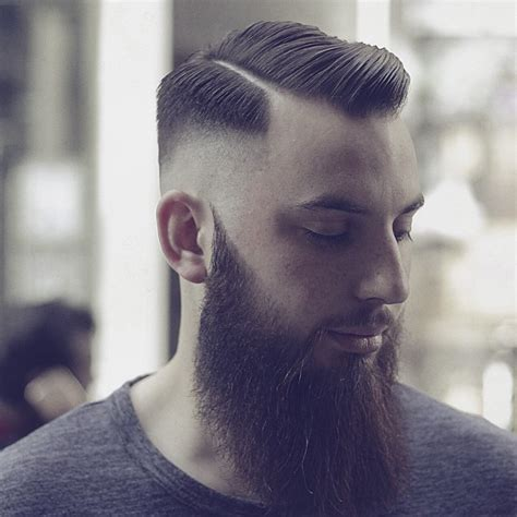 bald fade haircut and beard bald faded hard parted beard shaped by mr liptrot at the