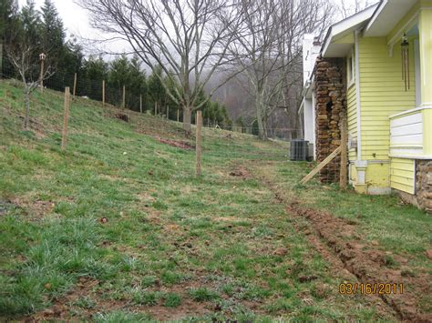 how to make a sloped backyard flat dealing with negative slope towards house homestead forum