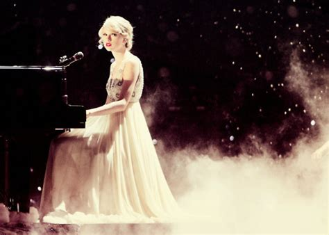 taylor swift enchanted piano post a picture of taylor playing piano taylor swift