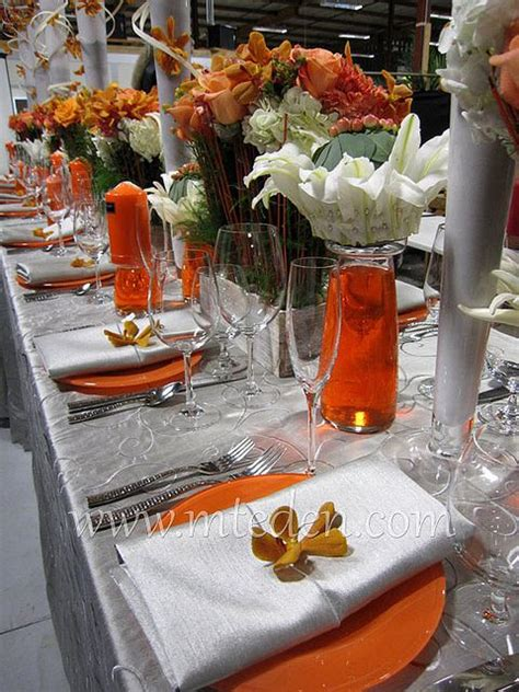 orange and silver wedding table orchids lilies weddings wedding decorations orange