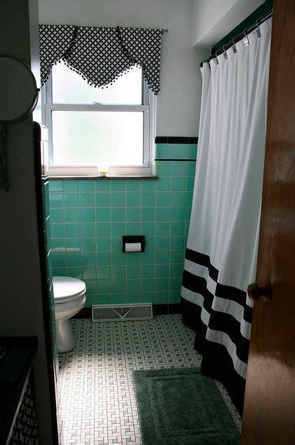 seafoam green  black trimmed tile walls   black