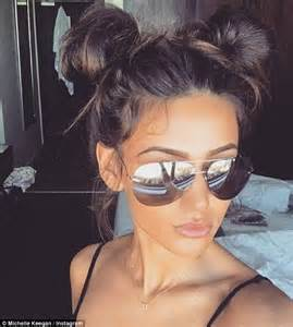 long hair buns for late 30 year old michelle keegan begins working in south africa as mark