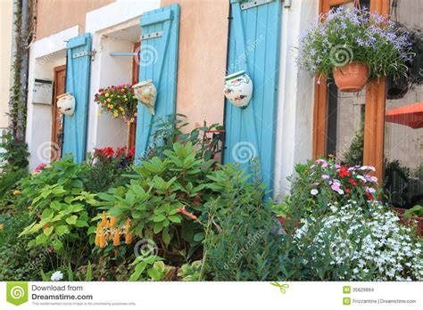 flowers house flowers and plants decorating house exterior stock photo