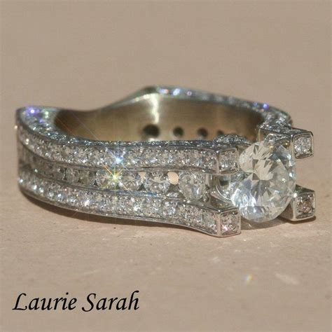 engagement ring with diamonds on the prongs side