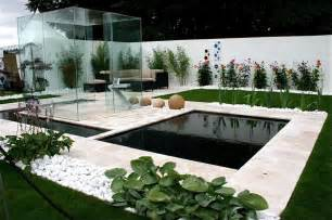 Garden furniture with small pond using glass wall olpos design