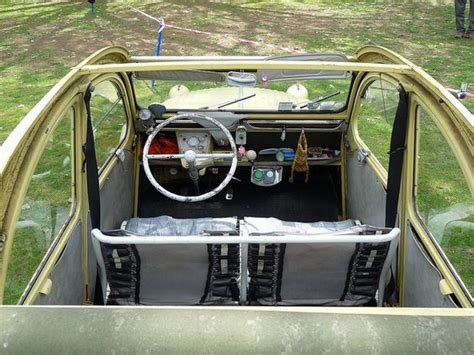 citroen 2cv interior early model has a sliding leather canopy which could be withdrawn to