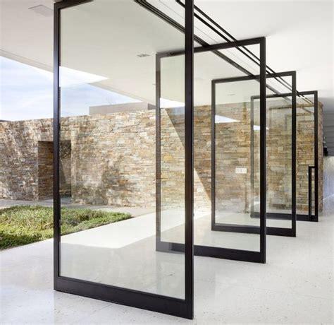 glass indoor outdoor door 15 bold and modern pivot doors to get inspired shelterness