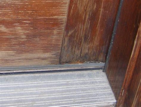 refinishing  wood front door     late