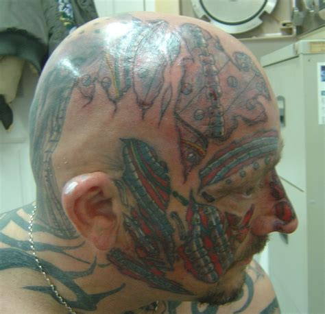 tattoo faces and bio mechanic tattoos photo 7779163