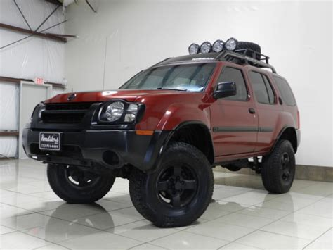 nissan xterra lifted road 5n1ed28y14c650827 nissan xterra xe 4x4 lifted roof bskt