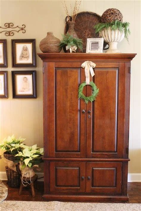 Top Of Armoire Decor by 1000 Ideas About Cabinet Top Decorating On
