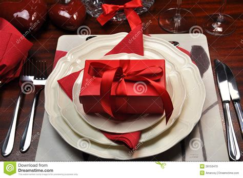 dinner gifts red romantic dinner table setting with gift stock photo