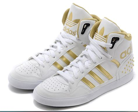 gold and white adidas shoes