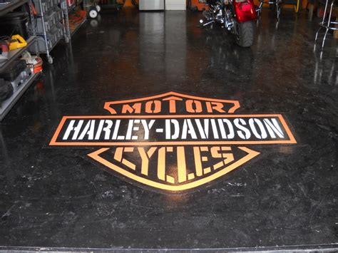 Sundek of San Antonio custom garage floor epoxy logo. For