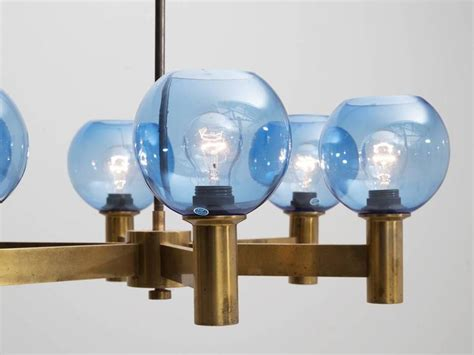 colored l shades chandelier in brass with blue colored glass shades for
