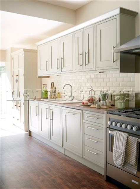 green and cream kitchen bd134 08 light green fitted kitchen with cream tiled