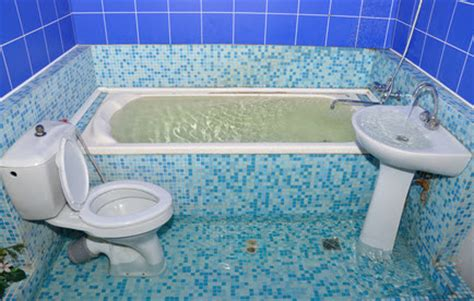 how to clean a flooded bathroom water damage from sink toilet and bathtub overflow