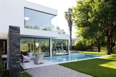pool glass walls lawn modern house in pilar buenos aires