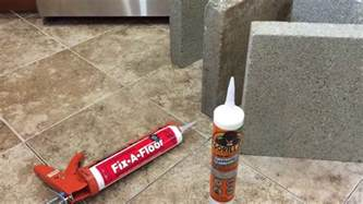 how to repair tiles using adhesive and fix a floor