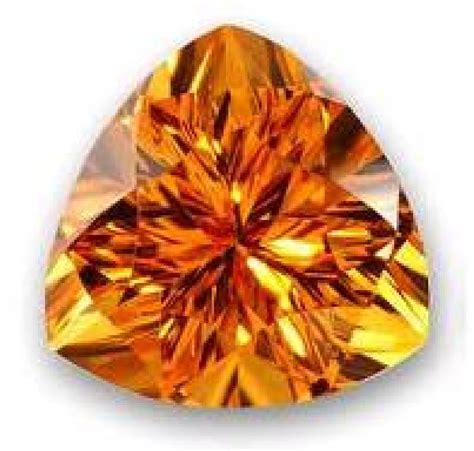 november birthstone topaz or citrine yellow topaz gemstone meaning