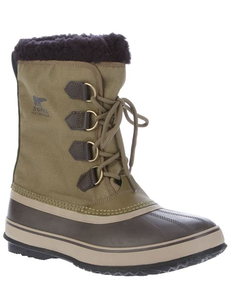 sorel pac boots sorel pac boot in green for lyst