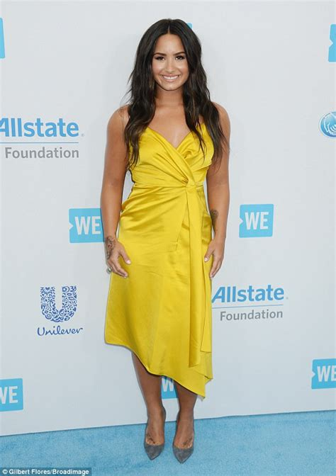 demi lovato stuns in gold silk dress at we day in la