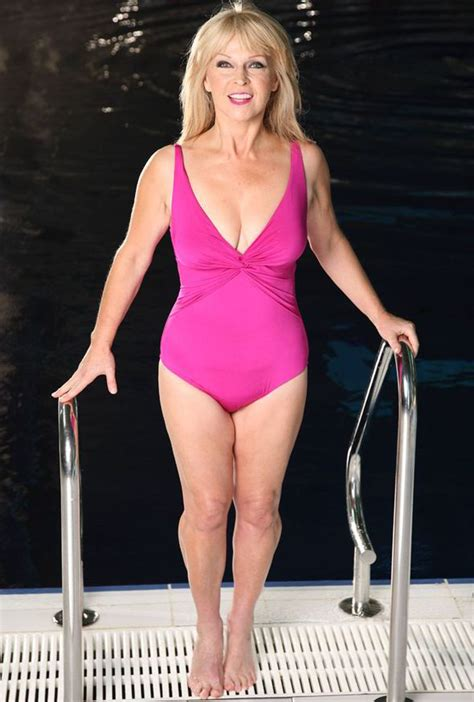 Big Bust From Dr Susan toyah wilcox flaunts fabulous figure in pink swimwear