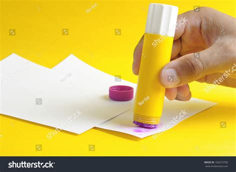 How To Make Paper Glue - applying purple glue stick white paper stock photo