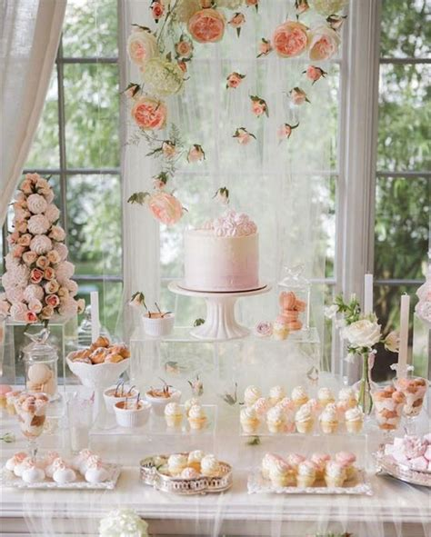 cake table backdrop and blush wedding dessert table with macarons and