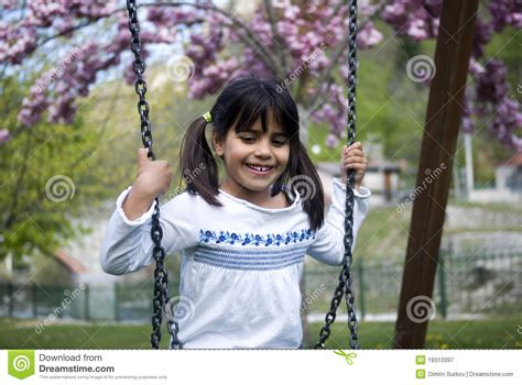 sitting swing young girl sitting on swing royalty free stock photography