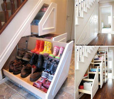 space saving under stairs hidden shoe storage idea with