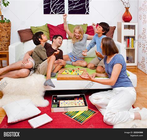 games to play in bed a young family is playing board games in their bed stock