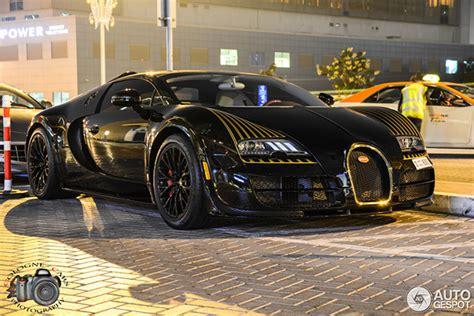 gold and black bugatti bugatti veyron black bess is spotted in dubai