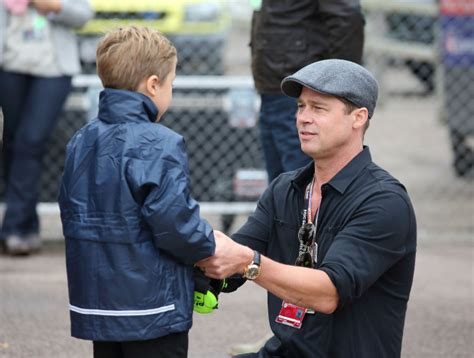 angelina jolie brings son knox to military supply store brad pitt goes silver fox as he films new film war machine