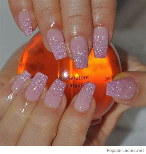 light pink long nails  glittered tips