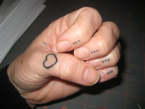 tattoo hand cross dots 60 cool heart tattoos on fingers
