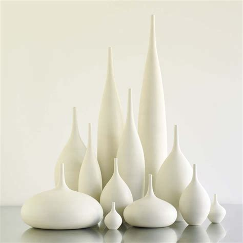 grand collection of 12 modern white matte ceramic vases by