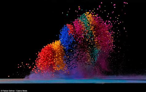 salt artist photographs the moment coloured salt is