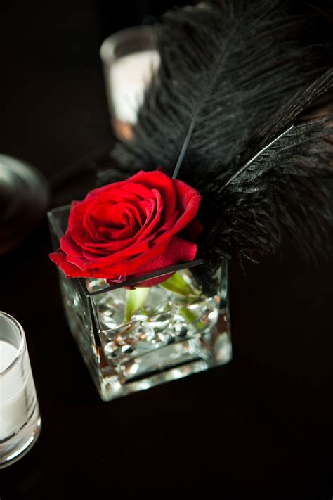 themes rosefeather wedding centerpiece singe red rose kind of like the
