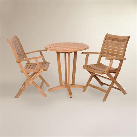 folding patio bistro set tanjun teak outdoor bistro set with folding armchairs world market